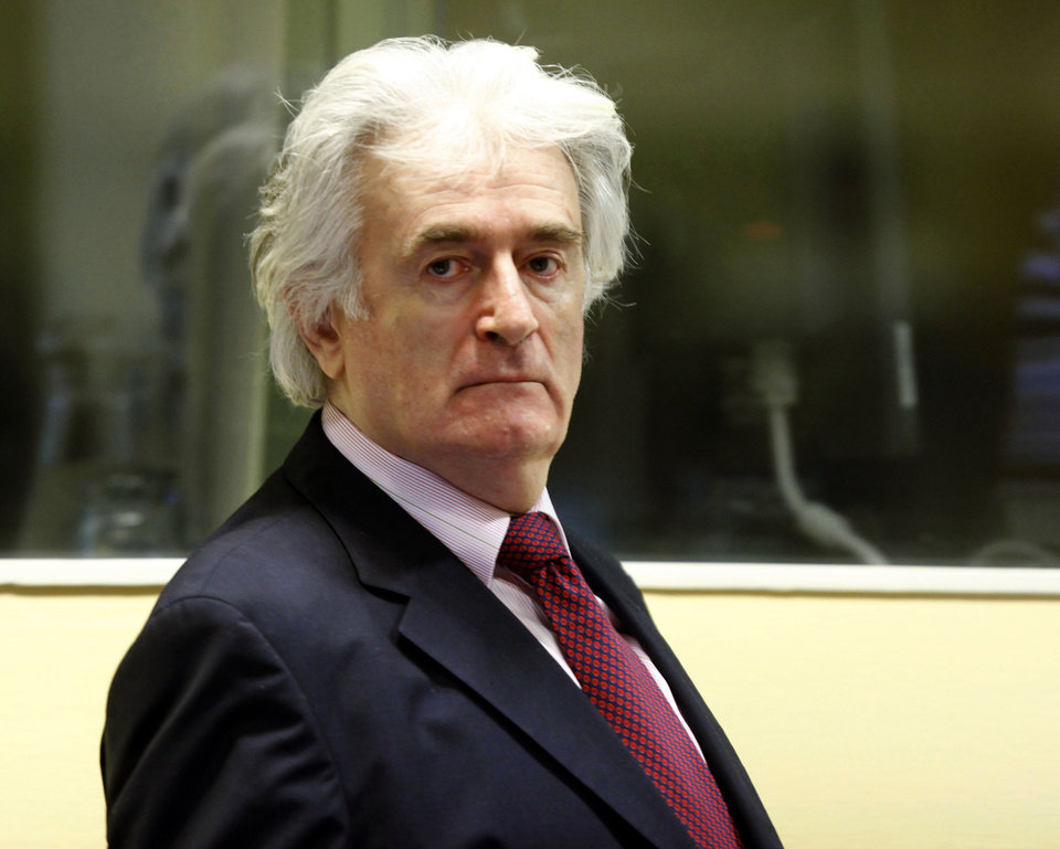 FILE - In this Nov. 3, 2009 file photo former Bosnian Serb leader Radovan Karadzic enters the courtroom of the U.N.'s Yugoslav war crimes tribunal (ICTY) in The Hague, Netherlands. The ICTY has acquitted Karadzic of one of the two genocide charges he faces at the halfway stage of his long-running trial on Thursday, June 28, 2012. Judges say prosecutors did not present enough evidence to support the genocide count covering mass killings, expulsions and persecution by Serb forces of Muslims and Croats from Bosnian towns early in the country's 1992-95 war. (AP Photo/Michael Kooren/Pool, File)
