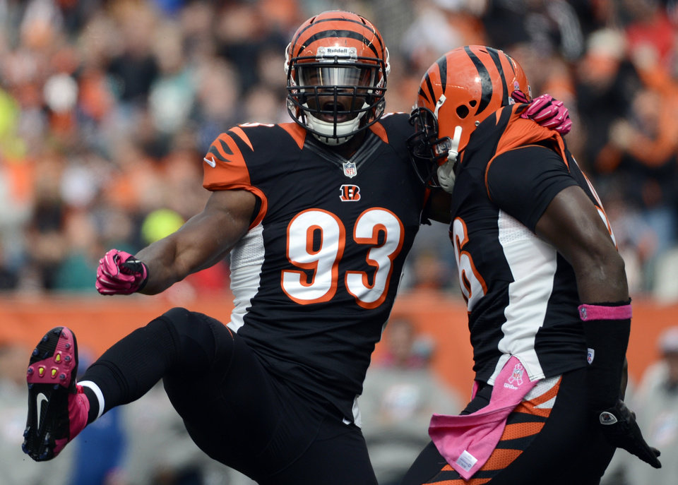 Photo -   Cincinnati Bengals defensive end Michael Johnson (93) celebrates with defensive end Carlos Dunlap after sacking Miami Dolphins quarterback Ryan Tannehill in the first half of an NFL football game on Sunday, Oct. 7, 2012, in Cincinnati. (AP Photo/Michael Keating)