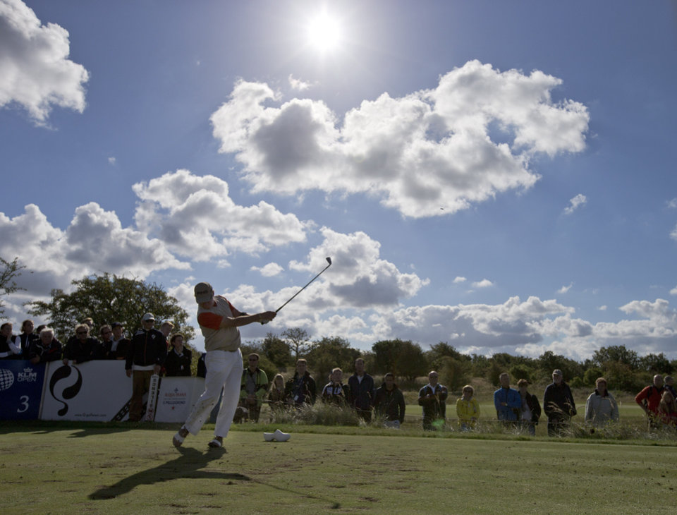 Photo - Spain's Miguel Angel Jimenez tees off on hole three during the final round of the KLM Open men's golf tournament in the beach resort of Zandvoort, western Netherlands, Sunday, Sept. 15, 2013. (AP Photo/Peter Dejong)