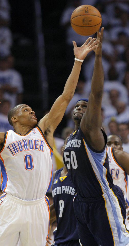 Oklahoma City\'s Russell Westbrook (0) grabs the ball beside Zach Randolph (50) of Memphis during game five of the Western Conference semifinals between the Memphis Grizzlies and the Oklahoma City Thunder in the NBA basketball playoffs at Oklahoma City Arena in Oklahoma City, Wednesday, May 11, 2011. Photo by Bryan Terry, The Oklahoman