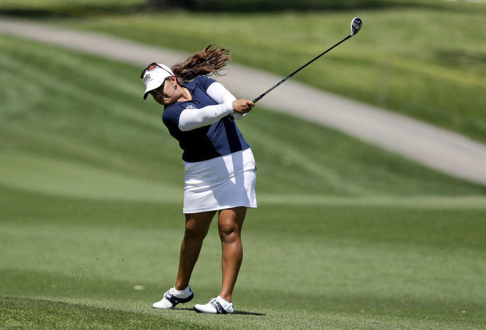 Photo - Lizette Salas hits from the fairway on the second hole during the second round of the LPGA Kraft Nabisco Championship golf tournament in Rancho Mirage, Calif., Friday, April 5, 2013. (AP Photo/Chris Carlson)