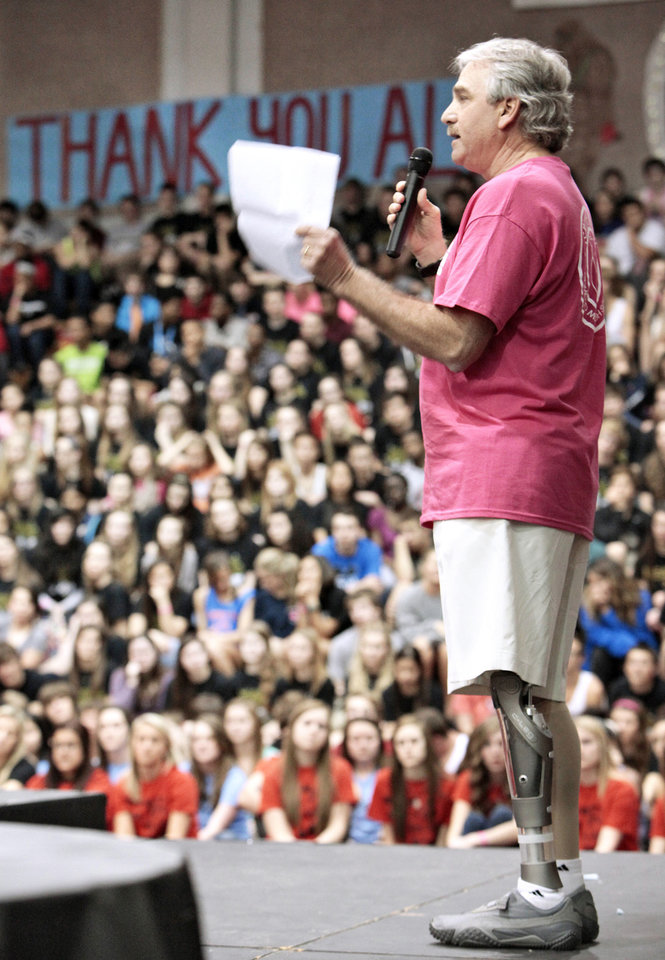 Doug Brooks with Limbs for Life spoke  during Edmond Memorial High School's final assembly for its  annual fundraiser.  Limbs for Life is a recipient for the funds raised. Photo By David McDaniel/The Oklahoman <strong>David McDaniel - The Oklahoman</strong>