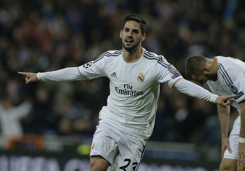 Photo - Real's Isco celebrates scoring his side's first goal during a Champions League quarterfinal first leg soccer match between Real Madrid and Borussia Dortmund at the Santiago Bernabeu stadium in Madrid, Spain, Wednesday April 2, 2014. (AP Photo/Paul White)