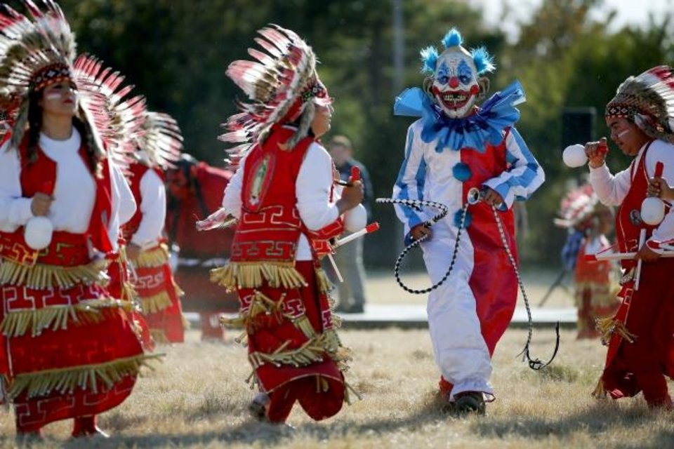 Photo -  Matachines from St. James the Greater Catholic Church dance during Sunday's groundbreaking for the Blessed Stanley Rother Shrine. [Bryan Terry/The Oklahoman]