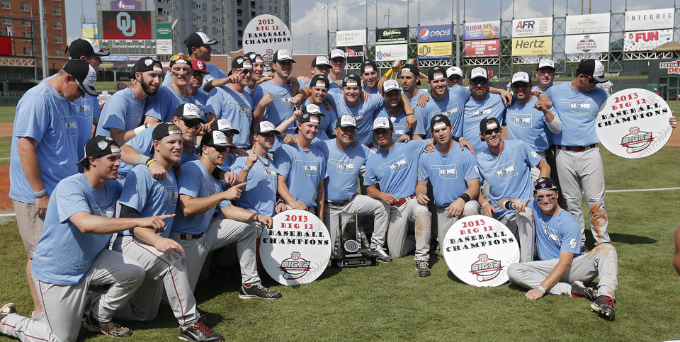 Photo - Oklahoma celebrates the 7-2 win over Kansas in the Big 12 Championship baseball with their 'Home' shirts in support of the tornado victims in the game between the University of Kansas Jayhawks (KU) and the University of Oklahoma Sooners (OU) at the Chickasaw Bircktown Ballpark on Sunday, May 26, 2013 in Oklahoma City, Okla.  Photo by Chris Landsberger, The Oklahoman