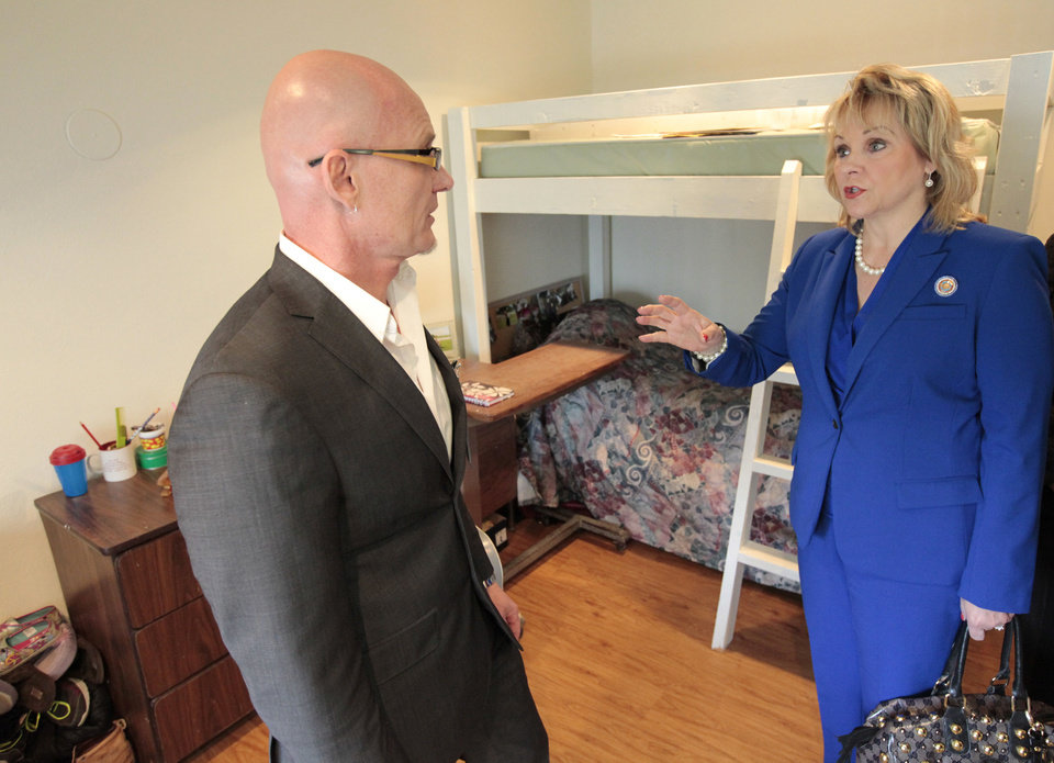 Photo - Michael Hanes, director of specialized services at Red Rock, on Friday gives Gov. Mary Fallin a tour of Jordan's Crossing, an Oklahoma City facility for pregnant and postpartum women and mothers in recovery.  David McDaniel - The Oklahoman