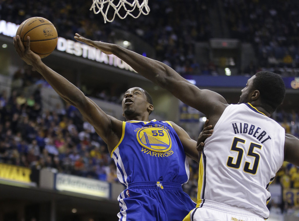 Photo - Golden State Warriors' Jordan Crawford (55) puts up a shot against Indiana Pacers' Roy Hibbert (55) during the first half of an NBA basketball game Tuesday, March 4, 2014, in Indianapolis. (AP Photo/Darron Cummings)