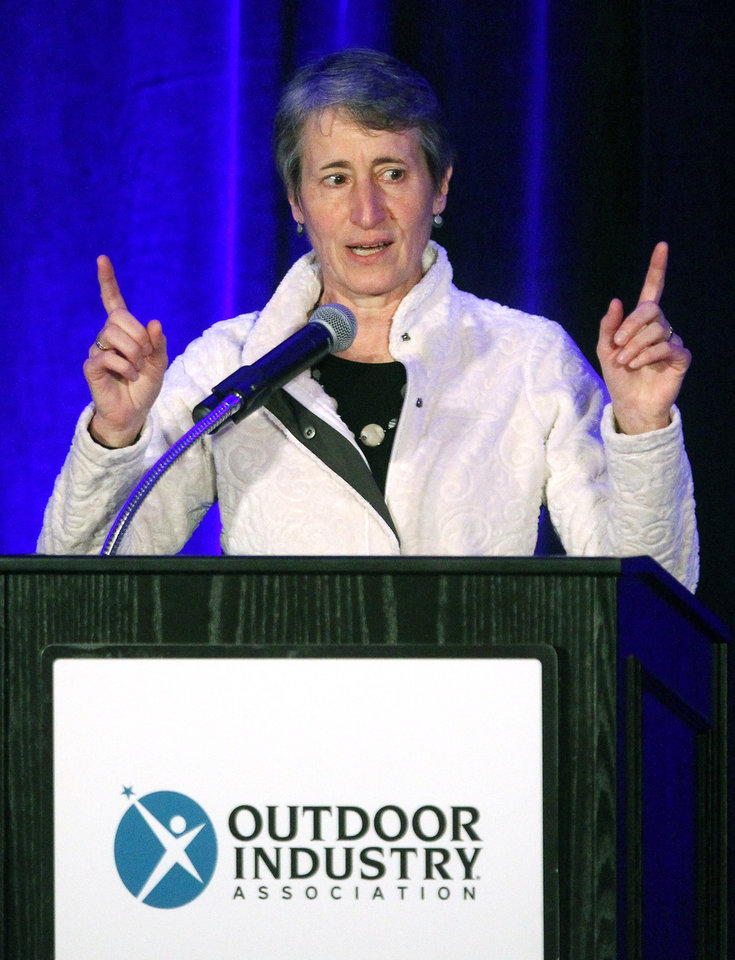 Photo - Secretary of the Interior Sally Jewell speaks to members of the Outdoor Industry Association at a trade show for outdoor gear makers Wednesday, Jan. 22, 2014, in Salt Lake City. Jewell made a pitch Wednesday for a privately funded youth conservation corps and sought donations for the effort from executives at an outdoor-gear trade show. (AP Photo/Rick Bowmer)