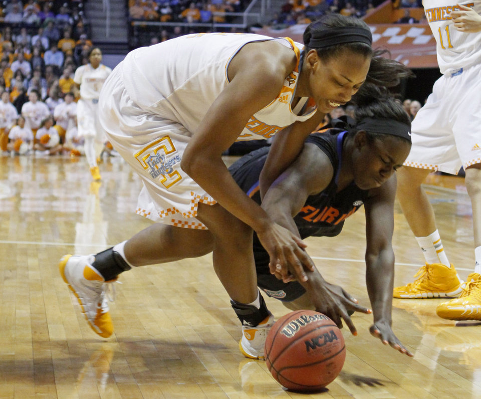 Photo - Tennessee forward Bashaara Graves (12) battles for the loose ball with Florida guard January Miller (3) in the first half of an NCAA college basketball game Thursday, Jan. 23, 2014, in Knoxville, Tenn. (AP Photo/Wade Payne)