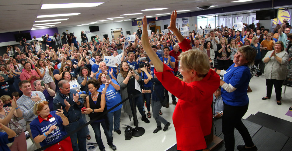 Photo - AFT President Randi Weingarten joins U.S. Senator and NWC Alum, Class of '66 Elizabeth Warren on the stage after the AFT education rally at Northwest Classen High School, Saturday, September, 22, 2018.  Photo by Doug Hoke, The Oklahoman
