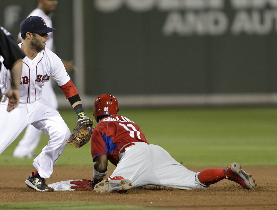 Photo - Philadelphia Phillies shortstop Jimmy Rollins (11) steals second on Boston Red Sox second baseman Dustin Pedroia in the third inning of an exhibition baseball game in Fort Myers, Fla., Saturday, March 15, 2014. (AP Photo/Gerald Herbert)