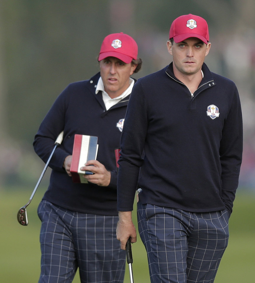 Photo -   USA's Phil Mickelson, left, and Keegan Bradley look over a shot on the first hole during a foresomes match at the Ryder Cup PGA golf tournament Friday, Sept. 28, 2012, at the Medinah Country Club in Medinah, Ill. (AP Photo/Charlie Riedel)