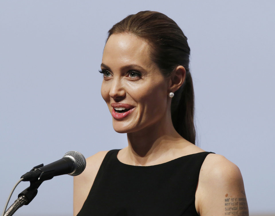 Photo - Angelina Jolie delivers a statement before screening her latest film