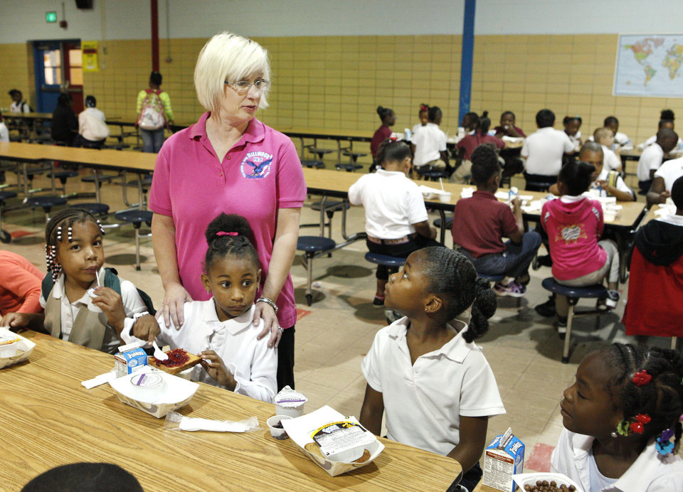 Photo - Kindergarten teacher Elizabeth Masson (CQ Masson),  talks with her students as they eat breakfast at Millwood Elementary School in the Millwood Public School District in Oklahoma City Thursday, May 16, 2013. Photo by Paul B. Southerland, The Oklahoman