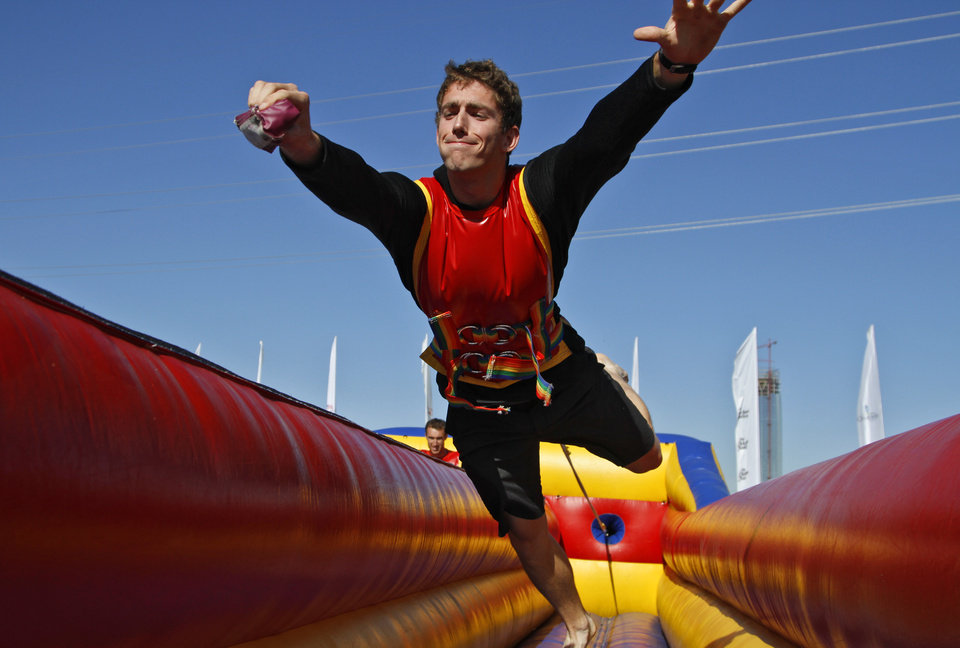 Henry Cole, of Oklahoma City, dives as he tries to mark his spot on the bungee race during the Oklahoma Regatta Festival at the Oklahoma River on Saturday, Oct. 1, 2011, in Oklahoma City, Okla. Photo by Chris Landsberger, The Oklahoman