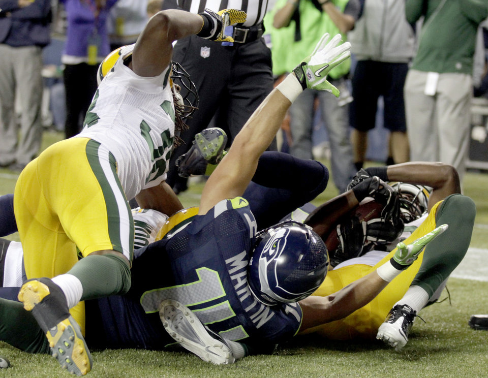 Photo -   Seattle Seahawks wide receiver Charly Martin (14) celebrates a last-second touchdown by wide receiver Golden Tate against the Green Bay Packers in the fourth quarter of an NFL football game, Monday, Sept. 24, 2012, in Seattle. Seattle won 14-12. (AP Photo/Stephen Brashear)