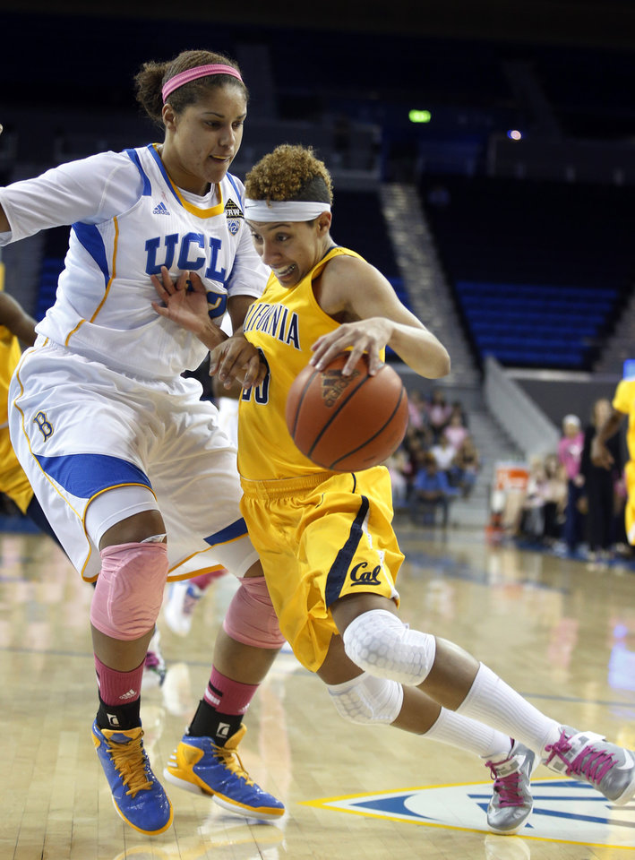 Photo - California guard Layshia Clarendon drives against UCLA forward Alyssia Brewer during the first half of an NCAA college basketball game in Los Angeles, Friday, Feb. 15, 2013. (AP Photo/Jae C. Hong)