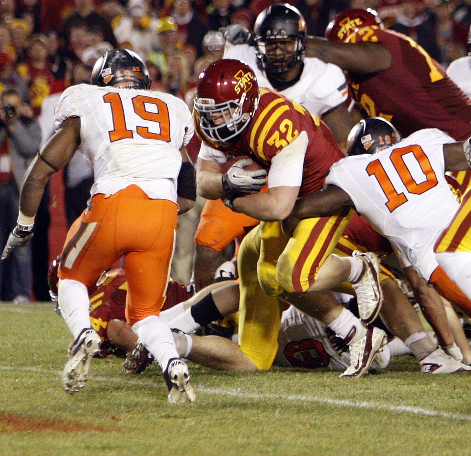 Photo - ISU's Jeff Woody (32) rushes for the winning score in double overtime as Markelle Martin (10) and Brodrick Brown (19) defend during a college football game between the Oklahoma State University Cowboys (OSU) and the Iowa State University Cyclones (ISU) at Jack Trice Stadium in Ames, Iowa, Friday, Nov. 18, 2011. Iowa State won, 37-31, in double overtime. Photo by Nate Billings, The Oklahoman