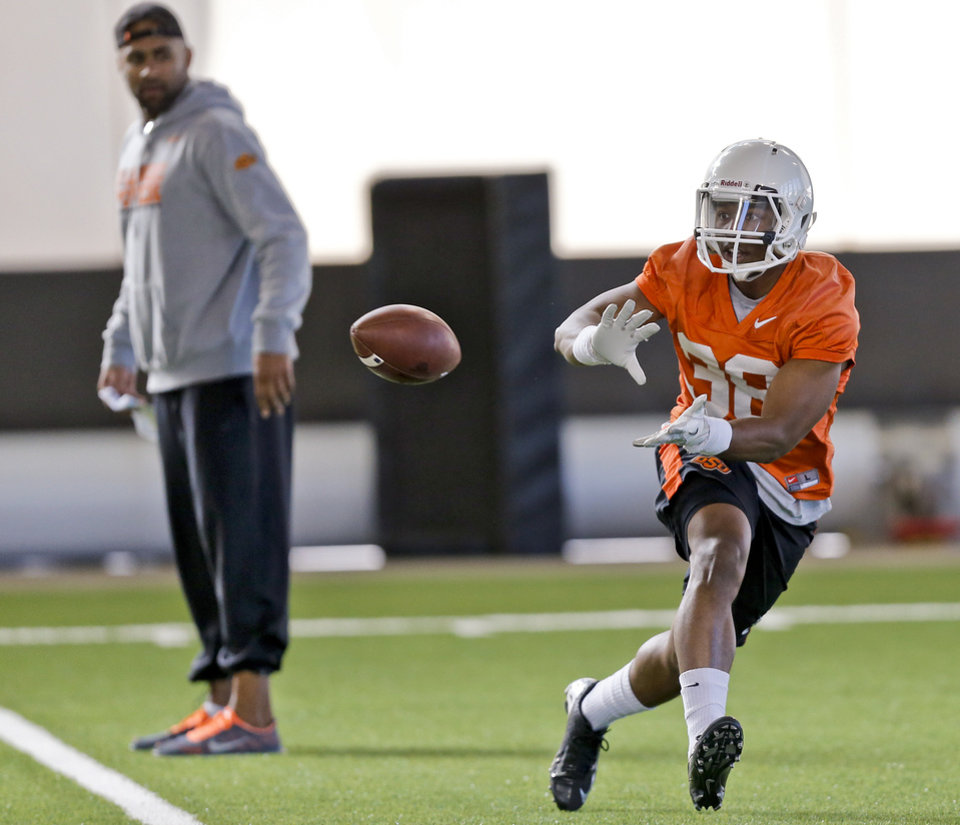 Photo - Kameron Doolittle (38) makes a catch during the first day of spring football practice at Oklahoma State University in Stillwater, Okla., on Monday, March 10, 2014.  Photo by Chris Landsberger, The Oklahoman