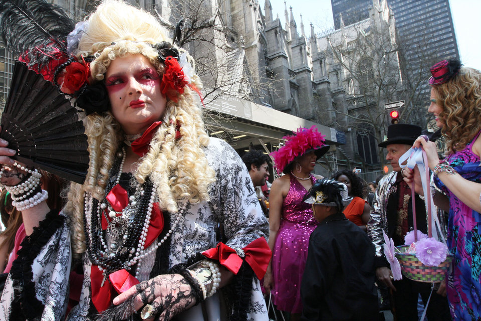 Photo -   Wearing a costume, Giovanni Figueroa of the Brooklyn borough of New York, left, poses for photographs as he and others take part in the Easter Parade along New York's Fifth Avenue on Sunday, April 24, 2011. (AP Photo/Tina Fineberg)