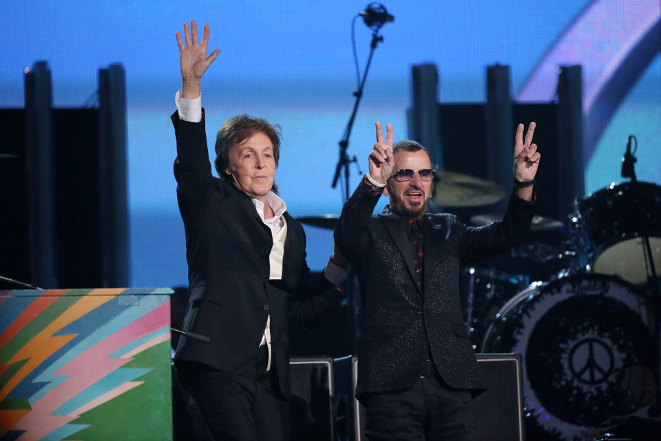 Photo - Paul McCartney, left, and Ringo Starr perform on stage at the 56th annual Grammy Awards at Staples Center on Sunday, Jan. 26, 2014, in Los Angeles. (Photo by Matt Sayles/Invision/AP)