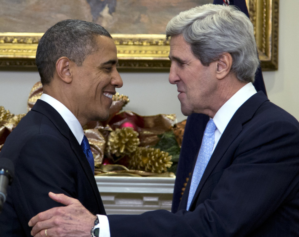 Photo - President Barack Obama looks to Sen. John Kerry, D-Mass., after announcing his nomination as the next secretary of state in the Roosevelt Room of the White House, Friday, Dec. 21, 2012, in Washington. (AP Photo/Carolyn Kaster)