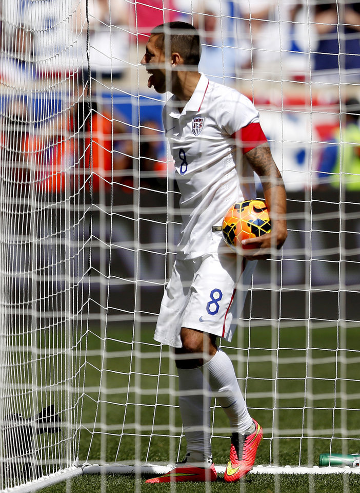 Photo - United States' Clint Dempsey celebrates after scoring a goal against Turkey in the second half of an international soccer friendly, Sunday, June 1, 2014, in Harrison, N.J. The U.S. won 2-1. (AP Photo/Julio Cortez)