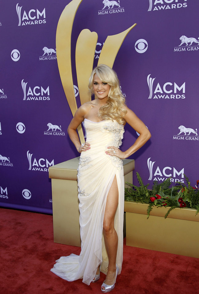 Photo - Carrie Underwood arrives at the 47th Annual Academy of Country Music Awards on Sunday, April 1, 2012 in Las Vegas. (AP Photo/Isaac Brekken)