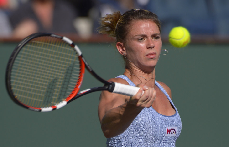 Photo - Camila Giorgi, of Italy, hits to Maria Sharapova, of Russia, during a third round match at the BNP Paribas Open tennis tournament, Monday, March 10, 2014 in Indian Wells, Calif. (AP Photo/Mark J. Terrill)