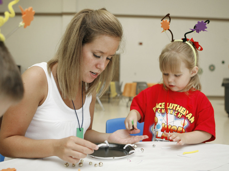 Volunteer Katherine Giles works on a craft with 3-year-old Madison Kohlmia, during the Power Lab Vacation Bible School at Peace Lutheran Church in Edmond, OK, Thursday, June 12, 2008. BY PAUL HELLSTERN, THE OKLAHOMAN
