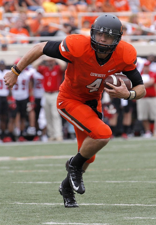 Photo - Oklahoma State's J.W. Walsh (4) rushes during a college football game between Oklahoma State University (OSU) and the University of Louisiana-Lafayette (ULL) at Boone Pickens Stadium in Stillwater, Okla., Saturday, Sept. 15, 2012. Photo by Sarah Phipps, The Oklahoman