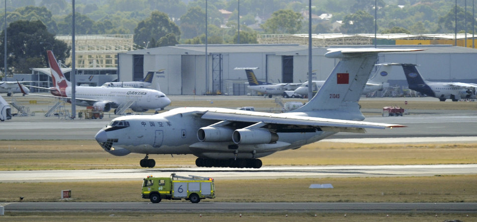 Photo - A Chinese Ilyushin IL-76 aircraft returns to Perth, Australia, International Airport Wednesday, April 16, 2014, to assist in the search for the missing Malaysia Airlines Flight 370 in the southern Indian Ocean. A robotic submarine looking for the lost Malaysian jet is continuing its second seabed search as up to 14 planes were to take to the skies for some of the final sweeps of the Indian Ocean for floating debris from the ill-fated airliner. (AP Photo/Greg Wood, Pool)