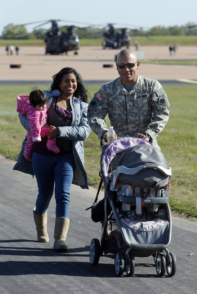 Tyrie Haught, Moore, wife Soniya and daughter Talia, nine months, head to a deployment ceremony for the149th General Support Aviation Battalion (GSAB), as they prepare for deployment to Afghanistan in support of Operation Enduring Freedom on Thursday, April 25, 2013 in Lexington, Okla.  Photo by Steve Sisney, The Oklahoman