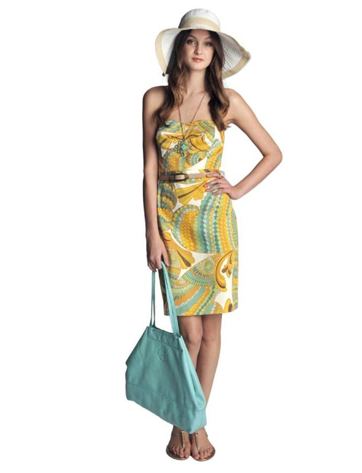 Photo - Banana Republic and Trina Turk are proud to announce the debut of the Banana Republic Trina Turk Collection, a limited-edition capsule featuring chic summer essentials inspired by the southern California lifestyle. Pictured here, Blue Pisces Printed Cora Strapless Dress, $150.00, Tan Skinny Oval Buckle Belt, $49.50, Turquoise Pendant, $49.50, Turquoise Cocktail Ring, $45.00, Turquoise Pinking Tote, $120.00, White Grosgrain Stripe Sunhat, $49.50, Gold Tonya T-Strap Flat Sandal,  $69.00. (Courtesy Banana Republic via Los Angeles Times/MCT)
