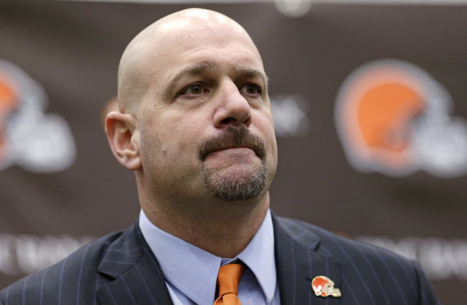 Photo - Cleveland Browns coach Mike Pettine listens to a question during a news conference Thursday, Jan. 23, 2014, in Berea, Ohio. Buffalo's defensive coordinator, who met with team officials for the first time just a week ago, finalized a contract Thursday to become the Browns' seventh full-time coach since 1999. (AP Photo/Tony Dejak)