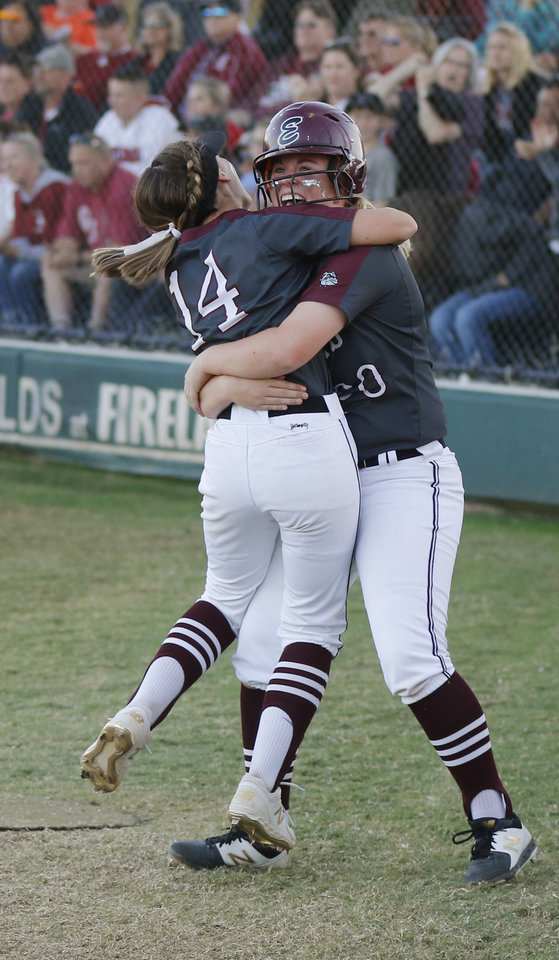 Photo - Memorial players #14 Mia Holliman and #20 Avery Flaming celebrate in the fifth inning during the 6A Fast Pitch Championship game between Edmond Memorial and Owasso at the Ball Fields at Firelake in Shawnee, Saturday, October 19, 2019. [Doug Hoke/The Oklahoman]