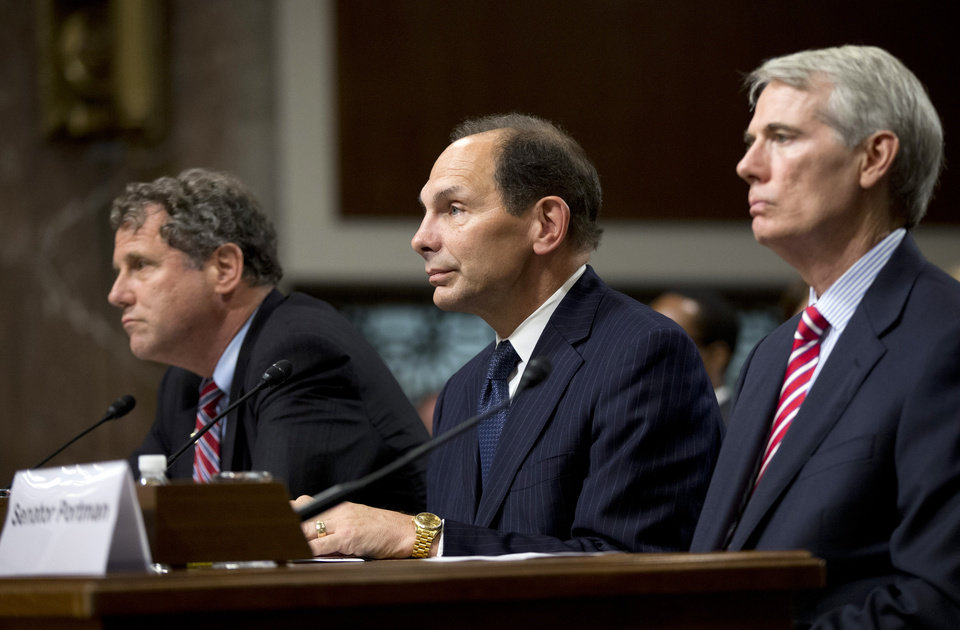 Photo - Veterans Affairs Secretary nominee Robert McDonald of Ohio flanked by Sens. Sherrod Brown, D-Ohio, left, and Rob Portman, R-Ohio, right, listen during a Senate Veterans' Affairs Committee hearings to examine his nomination to be Secretary of Veterans Affairs on Capitol Hill in Washington, Tuesday, July 22, 2014.  (AP Photo)