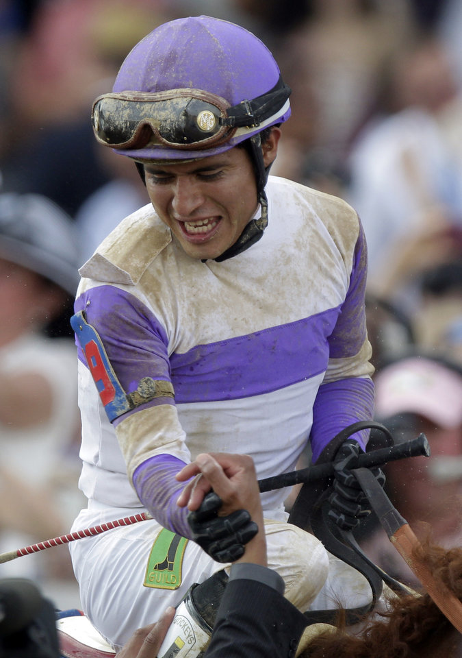 Jockey Mario Gutierrez reacts after riding I'll Have Another to victory in the 138th Kentucky Derby horse race at Churchill Downs Saturday, May 5, 2012, in Louisville, Ky. (AP Photo/Michael Conroy)  ORG XMIT: DBY225