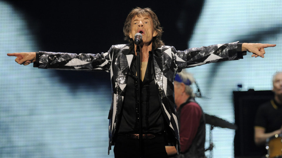 Photo - Mick Jagger of the Rolling Stones performs at the kick-off of the band's