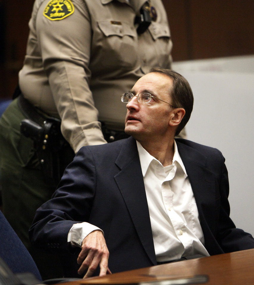 Photo - Christian Gerhartsreiter is led away by a Sheriff's deputy in a Los Angeles Superior Courtroom after a jury delivered a guilty verdict  on April 10, 2013 in Los Angeles.  The jury found Gerhartsreiter guilty in the death of a California man nearly three decades ago.  The verdict was reached Wednesday after the jury deliberated about a day.  Testimony in the cold-case trial of Gerhartsreiter focused on the discovery of the bones of John Sohus long after he and his wife disappeared from his mother's home in San Marino, a wealthy Los Angeles suburb.  The defendant, a German immigrant with delusions of grandeur, rented a cottage at the Sohus home in 1985 then disappeared about the same time as Sohus and his wife Linda who was never found.  (AP Photo/Los Angeles Times, Al Seib)  NO FORNS; NO SALES; MAGS OUT; ORANGE COUNTY REGISTER OUT; LOS ANGELES DAILY NEWS OUT; VENTURA COUNTY STAR OUT; INLAND VALLEY DAILY BULLETIN OUT; MANDATORY CREDIT, TV OUT