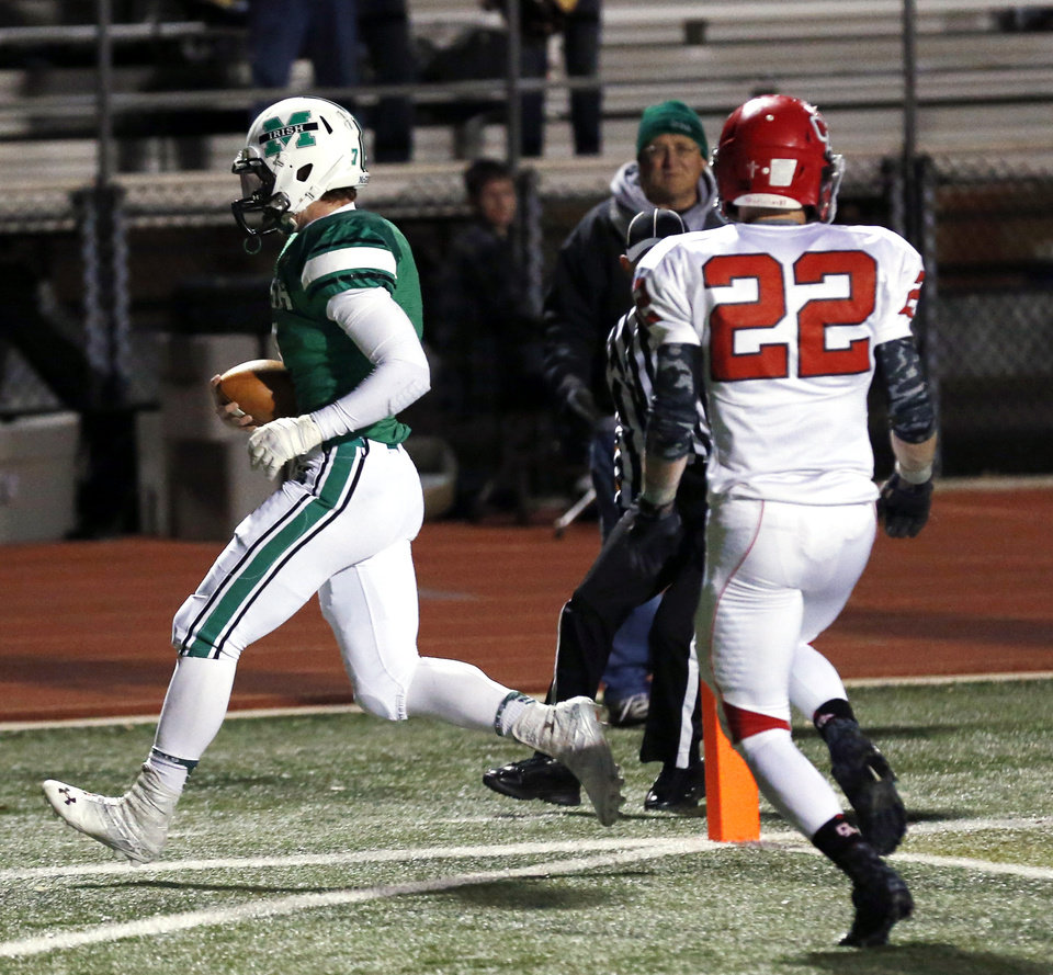 Irish quarterback Jacob Lewis scores untouched in the first half as the Bishop McGuinness Irish play the Carl Albert Titans in a Class 5A semi-final playoff game at Harve Collins Field on Friday, Nov. 23, 2012 in Norman, Okla. Photo by Steve Sisney, The Oklahoman