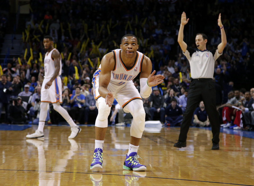 Photo - Oklahoma City's Russell Westbrook (0) reacts after a Thunder basket during an NBA basketball game between the Oklahoma City Thunder and the Philadelphia 76ers at Chesapeake Energy Arena in Oklahoma City, Tuesday, March 4, 2014. Photo by Bryan Terry, The Oklahoman
