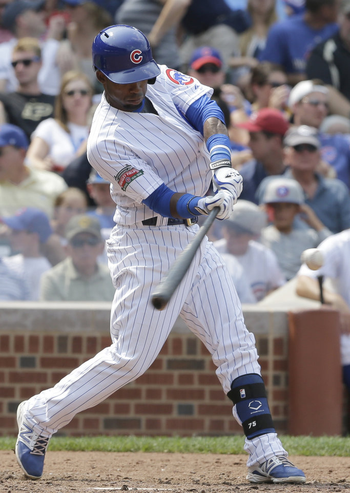 Photo - Chicago Cubs' Arismendy Alcantara (7) hits a single against the Colorado Rockies during the sixth inning of a baseball game in Chicago, Thursday, July 31, 2014. (AP Photo/Nam Y. Huh)