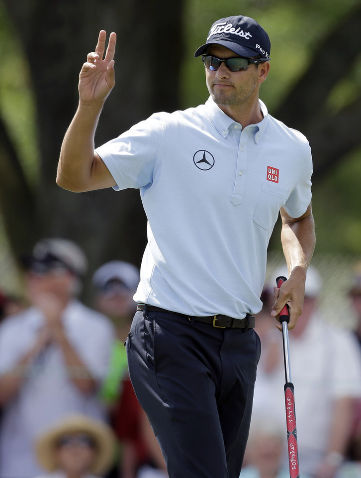 Photo - Adam Scott, of Australia, waves after making birdie on the ninth hole during the second round of the Arnold Palmer Invitational golf tournament at Bay Hill Friday, March 21, 2014, in Orlando, Fla. (AP Photo/Chris O'Meara)