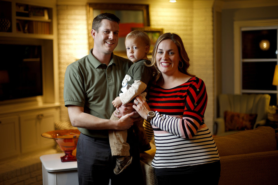 Jeff and Karlee Chill are with their son Griffin, 2, at their Oklahoma City home. Photo by Bryan Terry, The Oklahoman