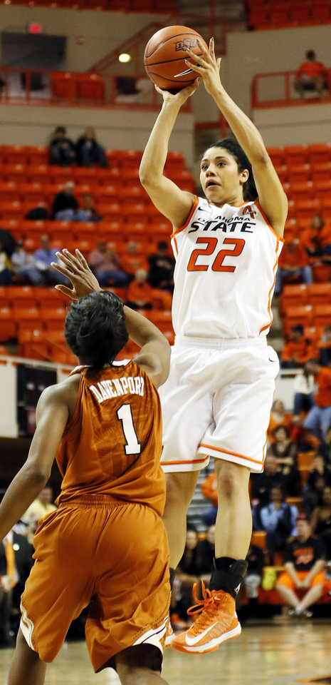 Photo - Oklahoma State's Brittney Martin (22) shoots over Texas' Empress Davenport (1) during a women's college basketball game between Oklahoma State University (OSU) and the University of Texas at Gallagher-Iba Arena in Stillwater, Okla., Saturday, March 2, 2013. Photo by Nate Billings, The Oklahoman