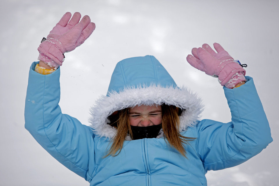Photo - Kaylin Varney, 11, slides down a hill after a snow storm in Oklahoma City, Tuesday, Feb. 1, 2011.  Photo by Bryan Terry, The Oklahoman