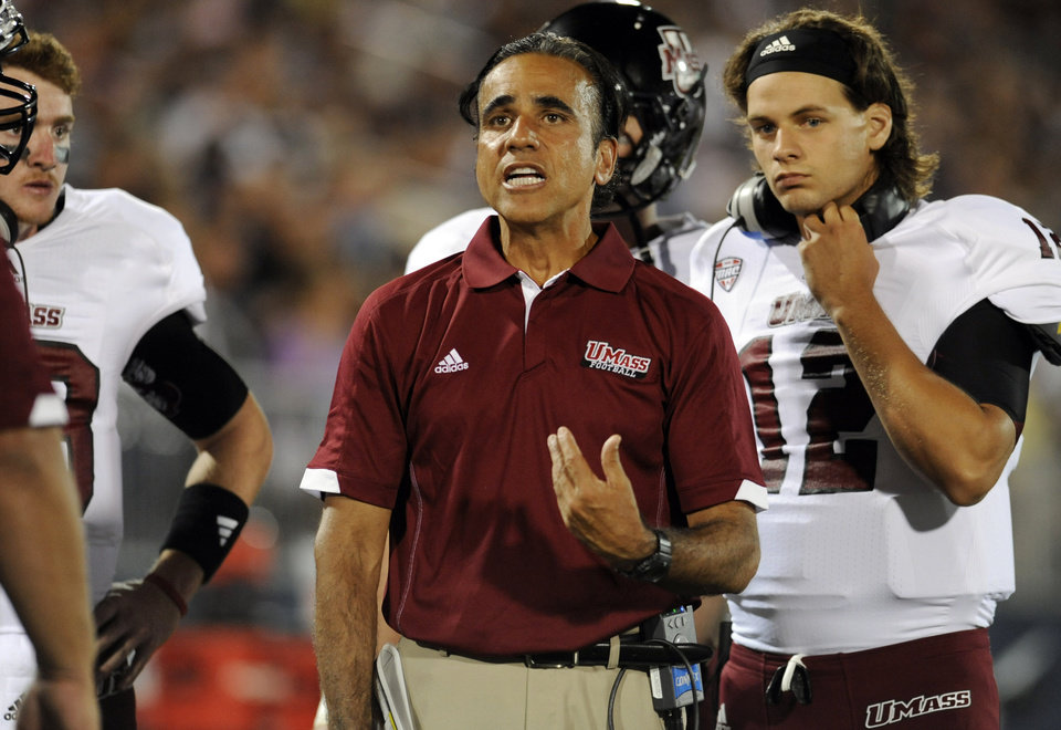 Photo -   Massachusetts head coach Charley Molnar, center, reacts during an NCAA college football game against Connecticut at Rentschler Field in East Hartford, Conn., Thursday, Aug. 30, 2012. (AP Photo/Jessica Hill)