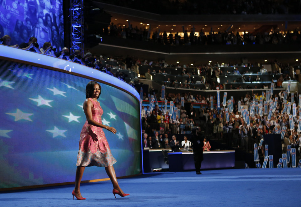 Photo - First Lady Michelle Obama waves to delegates at the Democratic National Convention in Charlotte, N.C., on Monday, Sept. 3, 2012. (AP Photo/Jae C. Hong)  ORG XMIT: DNC798