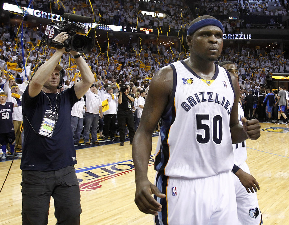 Photo - Memphis Grizzlies forward Zach Randolph (50) celebrates after beating the Oklahoma City Thunder in Game 6 of a second-round NBA basketball playoff series on Friday, May 13, 2011, in Memphis, Tenn. Randolph led the Grizzlies with 30 points as they won 95-83 to even the series 3-3. (AP Photo/Wade Payne)